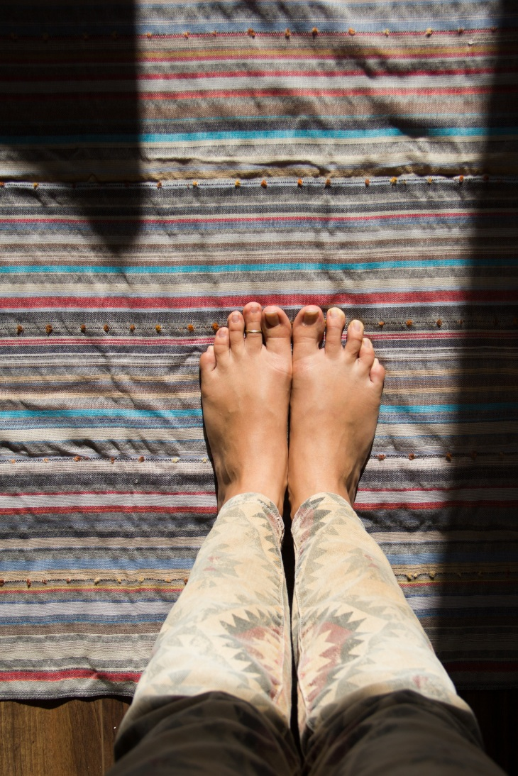 My feet, on my turkish towel, on my yoga mat.